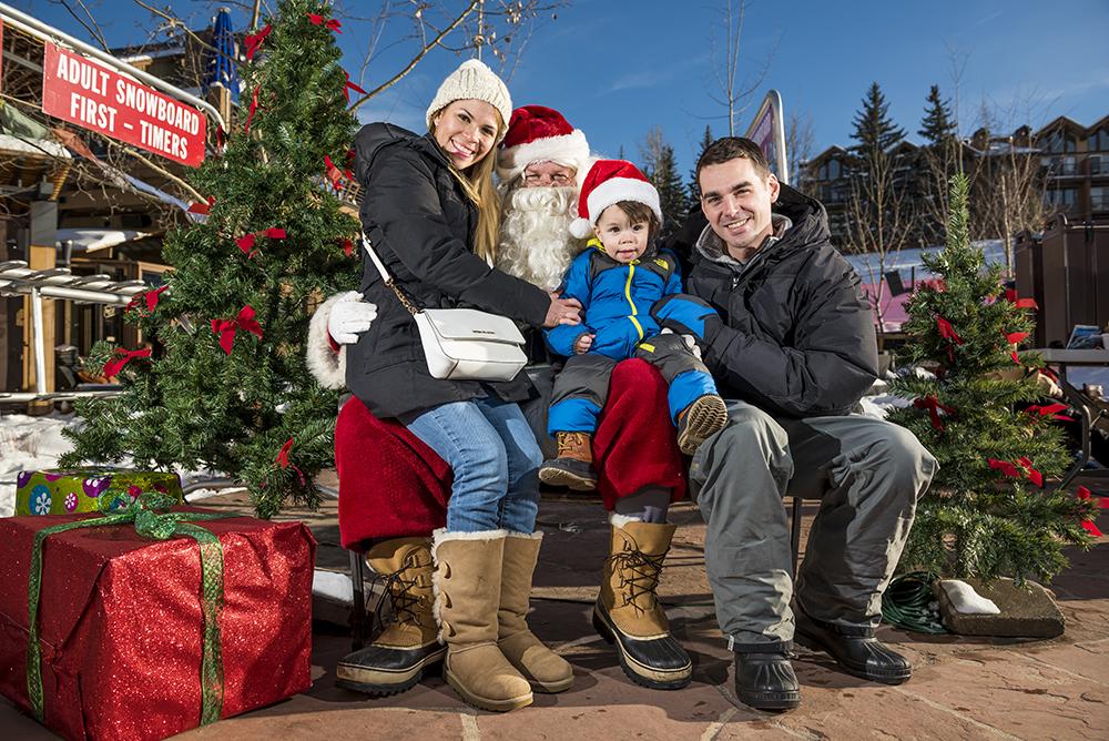 family visiting Santa in Snowmass Village